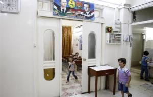 Syrian students in Damascus arrive for the first day of school. (AFP Photo/Anwar Amro)